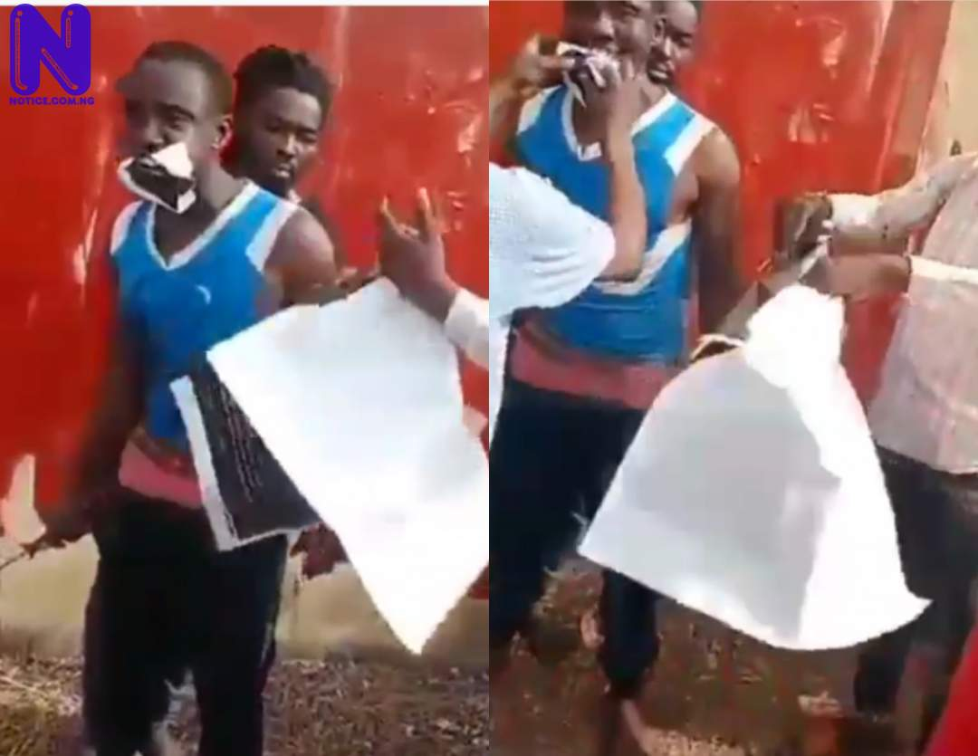Nigerian youths forced to eat 'Buhari Must Go' posters in Kogi (VIDEO) EY85R7CV
